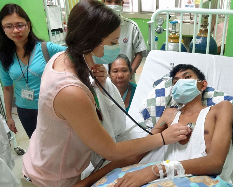 Ultimate Med Immersion – Students Examining a Patient